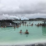 Relaxing in geothermal pools at the Blue Lagoon on a cloudy day.