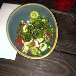 Poke - Fresh tuna, on top of sticky rice, avacado, cucumbers, topped w seaweed salad