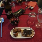 Appetizers: anchovy balls and bread with olive jam