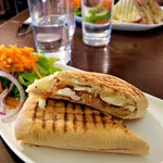 A grilled sandwich with a side salad -- perfect light lunch