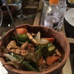 Chicken dish served in clay pot