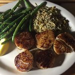 Scallops dinner served with sweet cornbread.