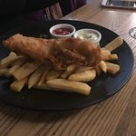 MASSIVE portions! This was the HALF fish and chips!!!