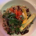 Vegetarian risotto with sundried tomatoes, squash, pea shoots