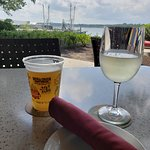 Enjoying drinks outside by the waterway.