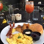 The perfect bacon, tators, eggs and biscuit breakfast. A Bloody Mary made with Zing Zang WOW !