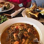 Delicious lunch, shrimp and grits, brisket sandwich with fresh cut fries, and more. Yum!