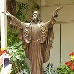 Bronze statue of Christ in gardens