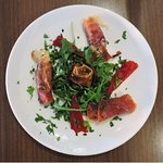 Grilled smoked scamorza cheese wrapped in Parma ham, with fresh rocket & drizzled with truffle o