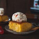 Delicious orange cake with parfait ice cream.