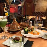 appetizer plate, tajine (meat and vegetables), lemonade with mint