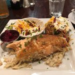 Hash Brown Crusted Salmon with loaded baked potato and warm cranberry orange relish