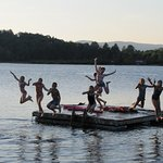 Kids jumping from float in the lake