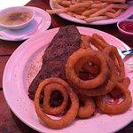 Steak Sandwich with onion rings and CHICKEN GRAVY