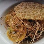Duck confit ravioli, locally foraged wild mushroom with shallot and truffle salsa