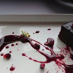 Wattle seed and pomegranate molasses cake served with mascarpone