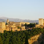 View of Alhambra from Mirador San Nicolas at sunset