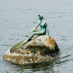 """This sculpture is called the girl in a wetsuit. It mikics the """"Little meremaid"""" in Copenhagen"""