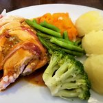 Prosciutto-wrapped chicken with veggies