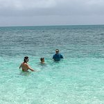 Swimming in the turquoise waters in front of Reef Beach House Villa