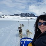 My wife on the sled tour.