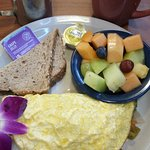 Green Omelet served with fruits on the side.