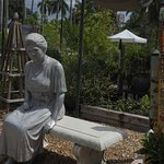 Mrs. Edison in a small garden at the Plant Shoppe