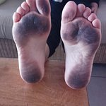 Filthy floor - wife's feet after walking around apartment for half a day