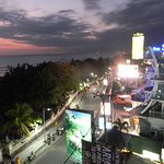 bird's eyeview of the bustling Kuta on beach road, taken from the rooftop
