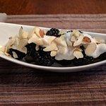 Blackbeerries with yogurt and shaved almonds. Yum!