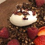 Raw cacao chia pudding, coconut yogurt, berries, cocao granola