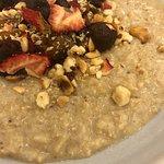 Brown Rice Porridge, almond milk, baked apple, date jame & hazelnuts