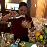 Ms Lei, charming staff at St Regis Bar, using her skill and recommendation to create the most en