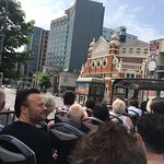 All aboard the tour bus, Heading Past Grand Opera House, and Europa Hotel