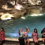 Granddaughter and I throwing coins into Trevi Fountain and hoping to return