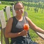 Enjoying fresh peach and wine slushies at the vineyard!