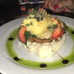 Lobster special over crab meat and spinach.