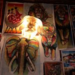 Artwork on the walls and Cape buffalo light