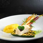 Fillet of atlantic cod sous vide in apple-celery juice, grilled zucchini, carrot sauce with lemo