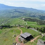 view from atop the tower of Fortezza di Radicofani - could be Switzerland in summer?