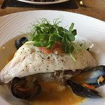 Grilled bream with crushed garlic potatoes & curry mussel cream