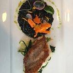 Scorpion fish with black cuttlefish rice