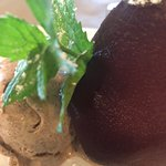 Poached pear infused with Port and homemade cinnamon gelato