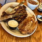 Rib eye steak and catfish with pinto beans