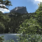 Clear water, green trees, blue ski, snowy mountain :)