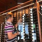 Owner Lloyd Davis gets our wine at Corner 103 in Sonoma.