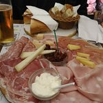 Meat and cheese platter, prosecco and beer