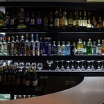 Well stocked bar with updated selection of wines