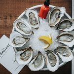 local oysters on the half shell served with house made fermented hot sauce