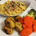 Early bird carbonara with veg and woof-fired rosemary and garlic roast potatoes
